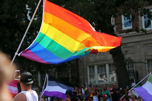 The PRIDE flag flies at the Dallas PRIDE Parade.