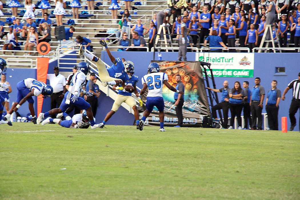 Senior Mauricio Sneed flies into the end zone against North Mesquite at the Cotton Bowl.