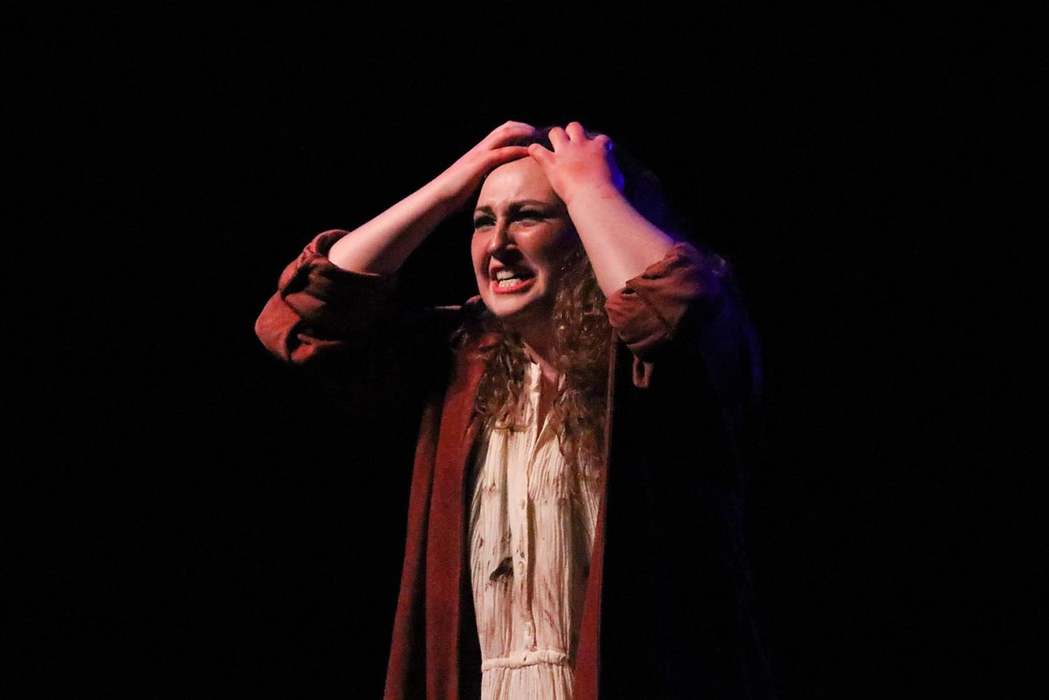 Lady Macbeth (KarLee Jones) speaks to the audience in a reaction shot during a performance.