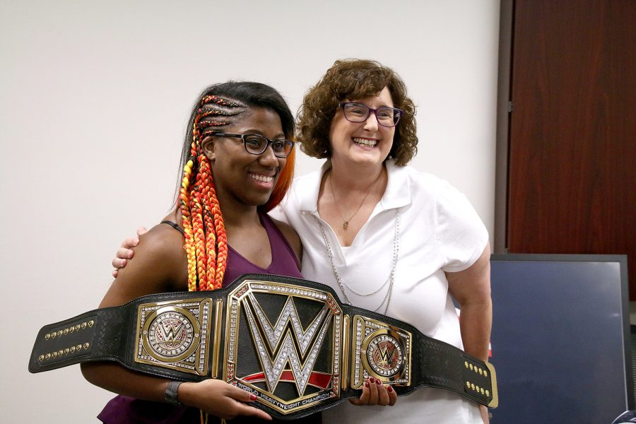 Adrienne Reese presents a championship belt to LC