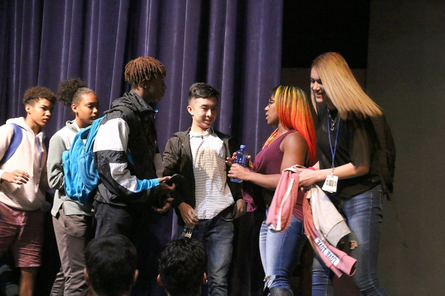 Adrienne Reese speaks to students after the assembly