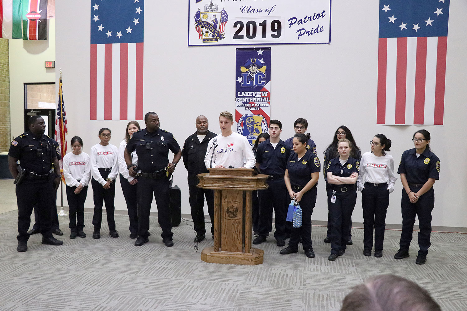 Skills USA Law students stand with law teacher Cedric Davis and multiple police officers at the