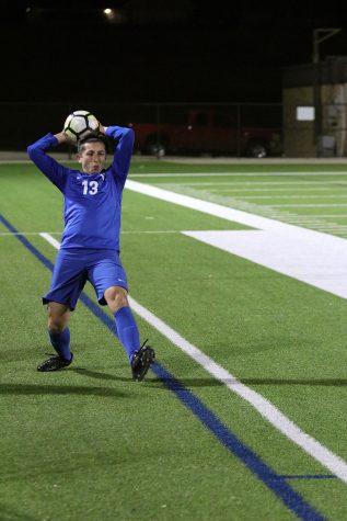 Junior Edward Leeper plays in varsity game against North Garland