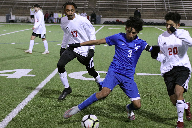 Sophomore Saul Leija plays against North Garland
