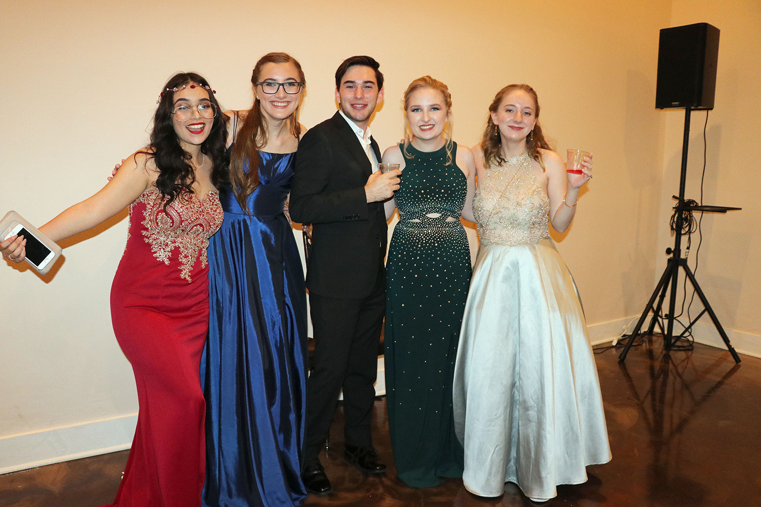 Junior Caroline Aguilar, senior Natalie Taylor, LC alumni Timothy Kihneman and seniors Madison Wester and Anne Kalinowsky smile for the camera at Prom