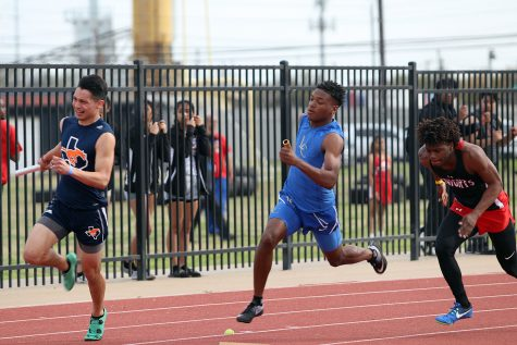 Junior Garnett Burke competes in a relay race.