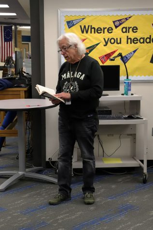 Mark Lee reads a poem during the literary festival.