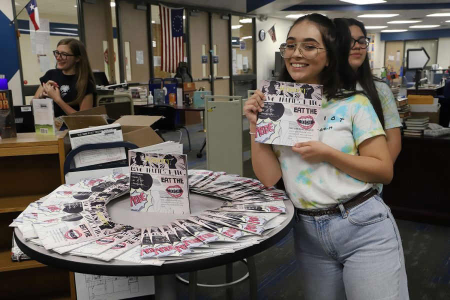Junior Caroline Aguilar poses with literary magazine.