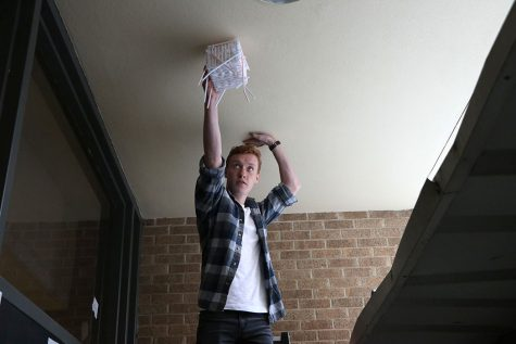Student participating in physics egg drop